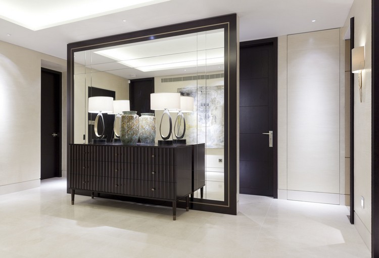 Entrance ideas with a wood sideboard and a large floor mirror home inspiration ideas